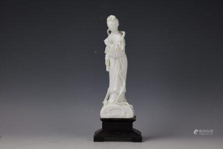A Chinese White Glazed Porcelain Figure of Chinese