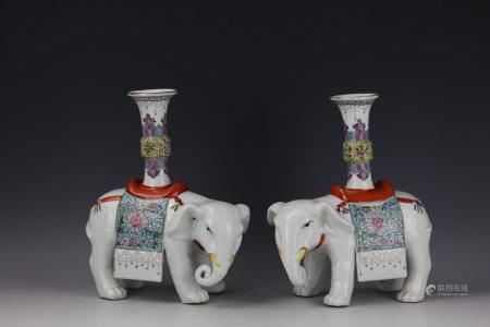 A Pair of Famille Rose Elephant Candle Stands