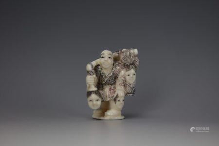 A Cattle Bone Carved Netsuke of a Man Carry Many Faces