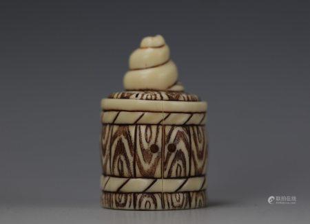 A Cattle Bone Carved Netsuke of Snail on a Barrel