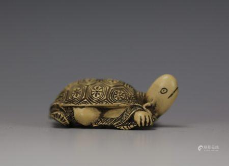 A Carved Netsuke of Tortoise God