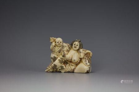 An Erotic Cattle Bone Carved Netsuke of a Young Man