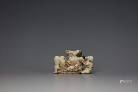 An Erotic Cattle Bone Carved Netsuke of a Boy Washing a