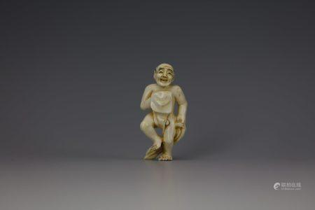 An Erotic Cattle Bone Carved Netsuke of a Partially