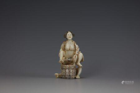 An Erotic Cattle Bone Carved Netsuke of a Couple Having