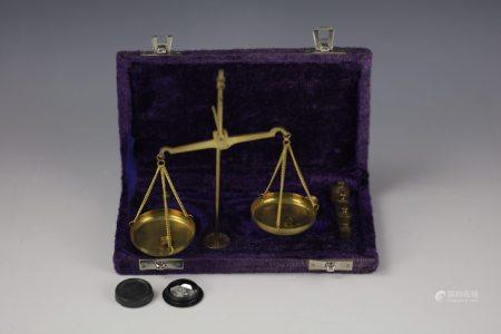 Vintage brass portable balance with weight and box