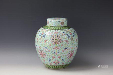 A Blue Ground Famille Rose Flower Porcelain Jar