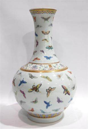 A Chinese Famille Rose Hundred-Butterflies Bottle Vase, Guan