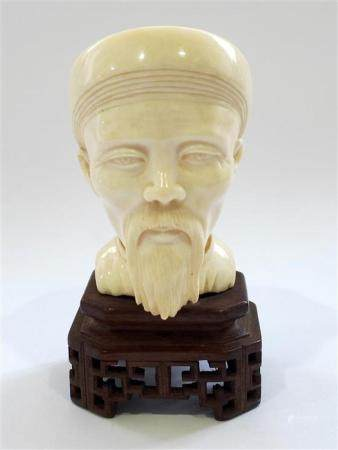 A Carved Ivory Bust of a Distinguished Gentleman with Lean F