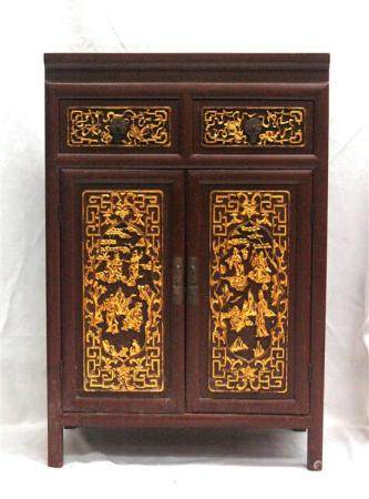A Chinese Red Lacquer Cabinet Inset with Carved & Pierced Gi