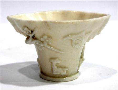 A Porcelain Libation Cup Molded with Longevity Symbols, Qing