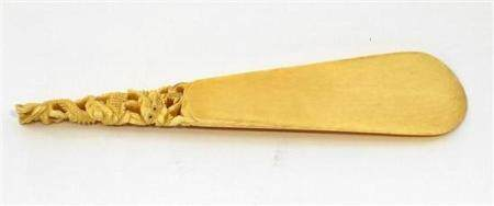 A Chinese Ivory Shoe Horn Carved & Pierced with a Writhing D
