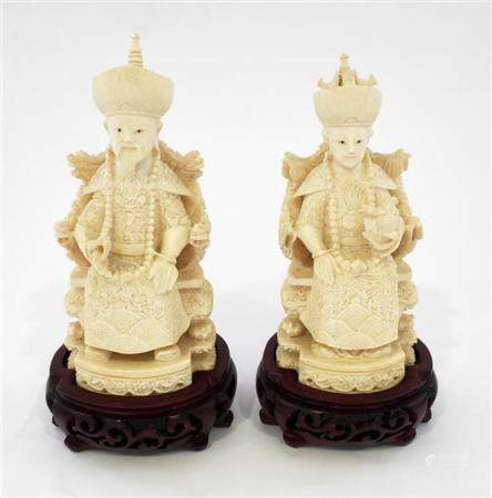 A Pair of Finely Carved Ivory Figures of a Chinese Emperor &
