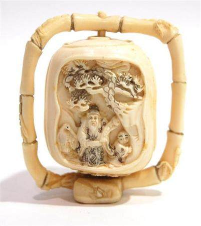 A Mammoth Ivory Three Sided Lantern that Swivels on a Frame