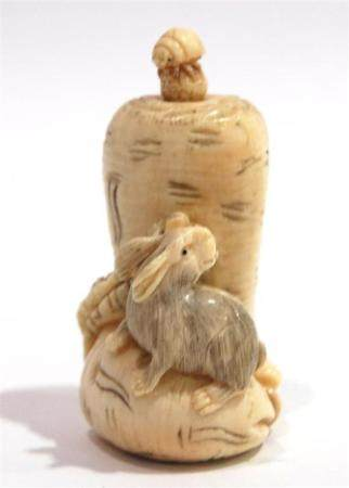 A Mammoth Ivory Snuff Bottle of Rabbit Standing on a Large C