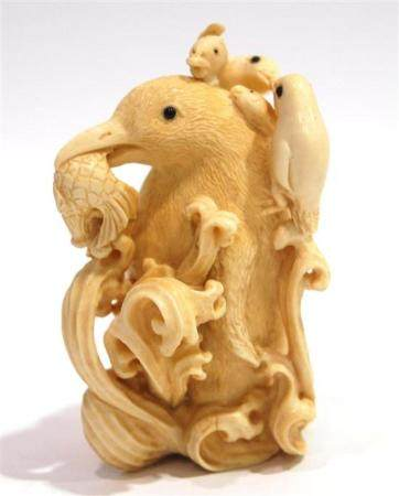 A Mammoth Ivory Snuff Bottle of an Emperor Penguin Carrying