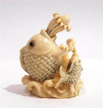 A Mammoth Ivory Snuff Bottle of a Large Fish the Stopper of