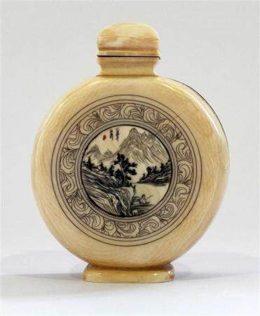 A Large Flat Round Ivory Snuff Bottle has a Central Engraved