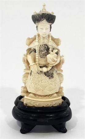 An Ivory Consort Seated on a Phoenix Throne, Wearing Ceremon