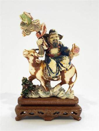 An Ivory Figure of a Farmer Returning on the Back of His Ox,