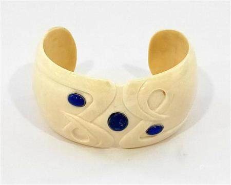A Carved ivory Wide Cuff Bangle Inlaid with Three Cabochon o