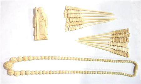 A Strand of Carved Mammoth Ivory Beads, A God of Longevity C