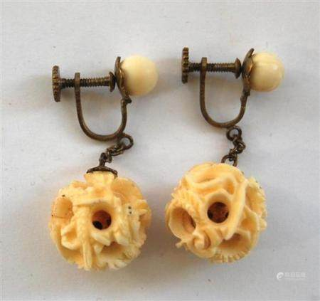 A Pair of Carved Ivory Puzzle Ball Earrings, Suspended on a