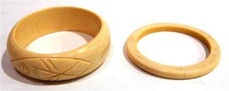 Two Mammoth Ivory Bangles, the Heavy D Profile Carved with a