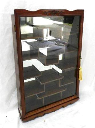 A Glazed Display Cabinet of Rectangular Form with Mirror Bac