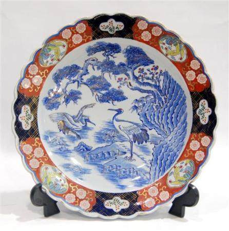 A Porcelain Arita Charger with a Scalloped Edge, Impressed M