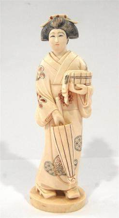 A Japanese Ivory Beauty, Dressed in a Formal Brocade Kimono,