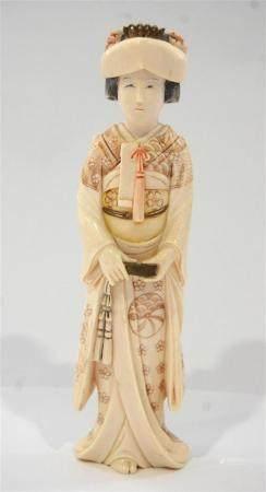 A Japanese Ivory Beauty, in a Brocade Kimono, Showa Period,