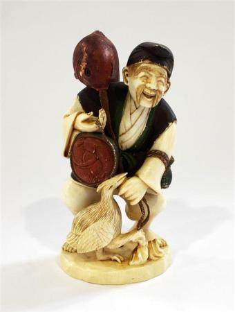 A Japanese Ivory Figure of a Fisherman with his Catch on His