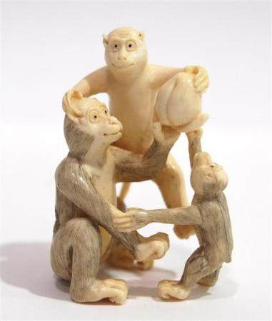 A Comically Carved Mammoth Ivory Ojime of Three Monkeys with