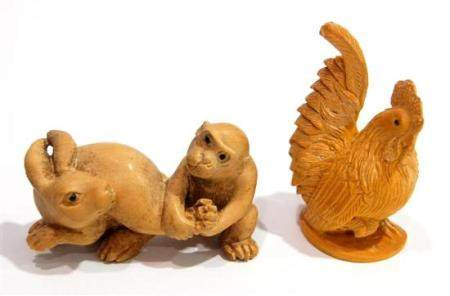 A Carved Wood Netsuke of a Hare & a Monkey Pulling the Left