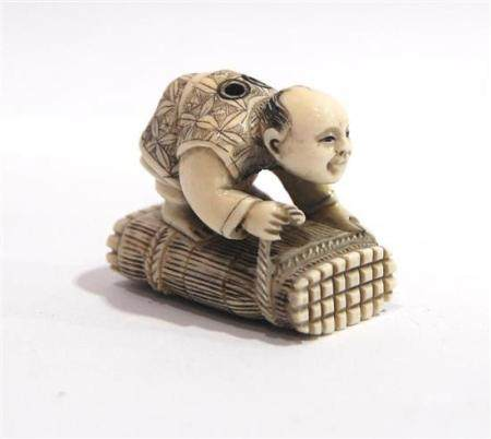 A Marine Ivory Netsuke, of a Man Tieing up his Twigs, Signed