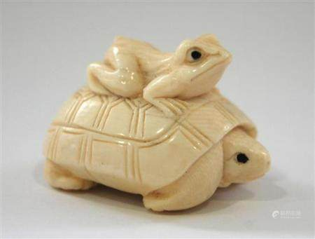 A Japanese Ivory Netsuke of a Turtle with a Frog on his Back