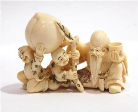 A Mammoth Ivory Netsuke of the God of Longevity & Two Boys B