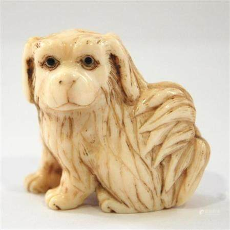 A Carved Ivory Puppy Dog Netsuke, Ink Decorated with Incised