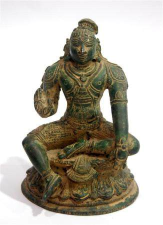 A Copper Alloy of Shiva Seated in a Pose with his Left Leg R