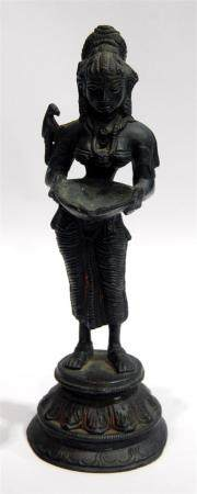 A Slender Standing Deity Carrying a Bowl with a Bird on Her
