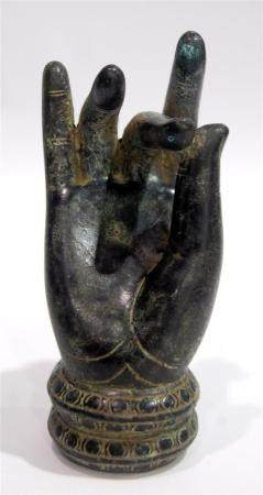 A Buddha Hand in Dark Bronze Alloy the Palm Upright with the