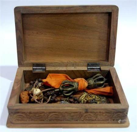 A Sandalwood Box with a Tibetan Dorji, Votive Beads & Repous