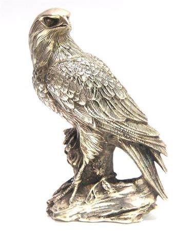 A Silver Metal Eagle Realistically Cast Standing with One Ta