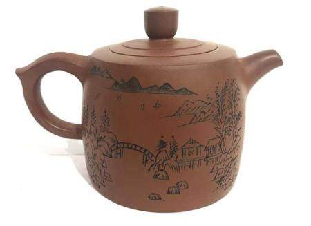 A Chinese Yixing Zisha Teapot Incised with Landscape & Calli
