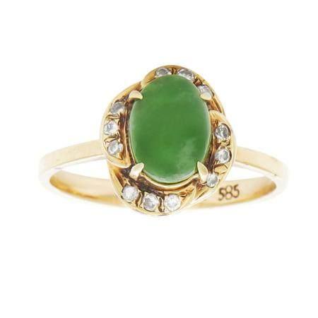 JADEITE JADE AND DIAMOND RING the oval jade cabochon