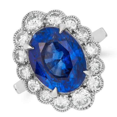 5.96 CARAT SAPPHIRE AND DIAMOND CLUSTER RING set with