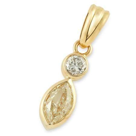 DIAMOND PENDANT set with a marquise cut yellow diamond