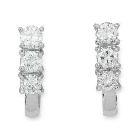 DIAMOND EARRINGS each set with three round cut