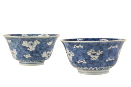TWO SIMILAR BLUE AND WHITEFLARED 'PRUNUS' BOWLS, KANGXI PERIOD